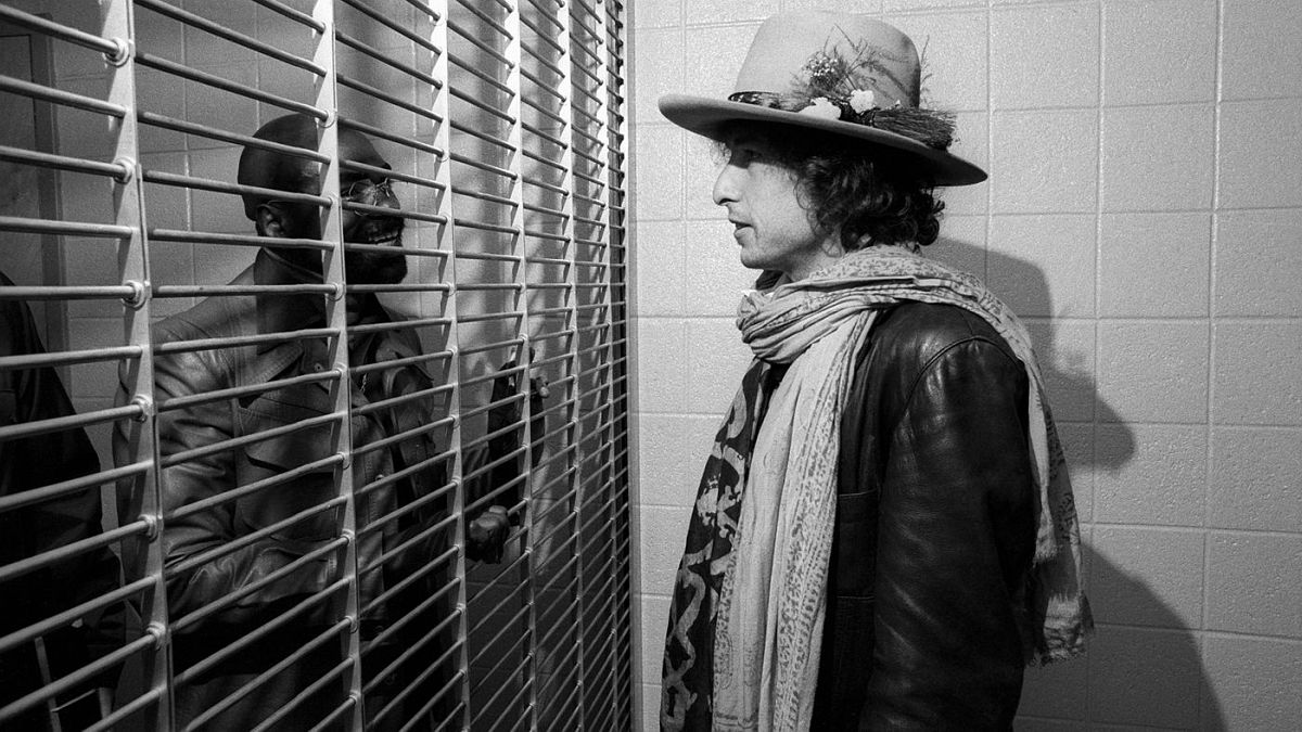 "Shortly before launching the Rolling Thunder Revue, Dylan became aware of the plight of boxer Rubin ""Hurricane"" Carter, who was in prison for a murder he claimed he didn't commit."