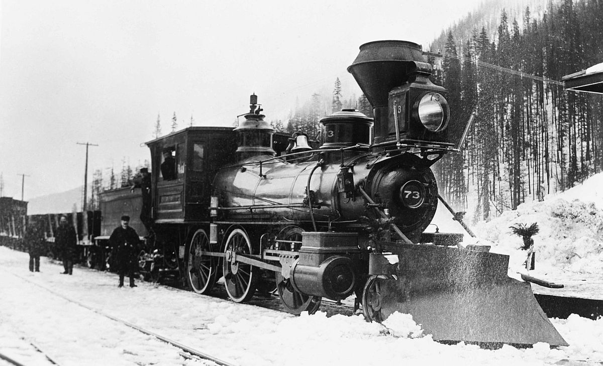 Canadian Pacific Railway engine 73 and train, Rogers Pass, British Columbia. Date: [ca. 1887-1889]