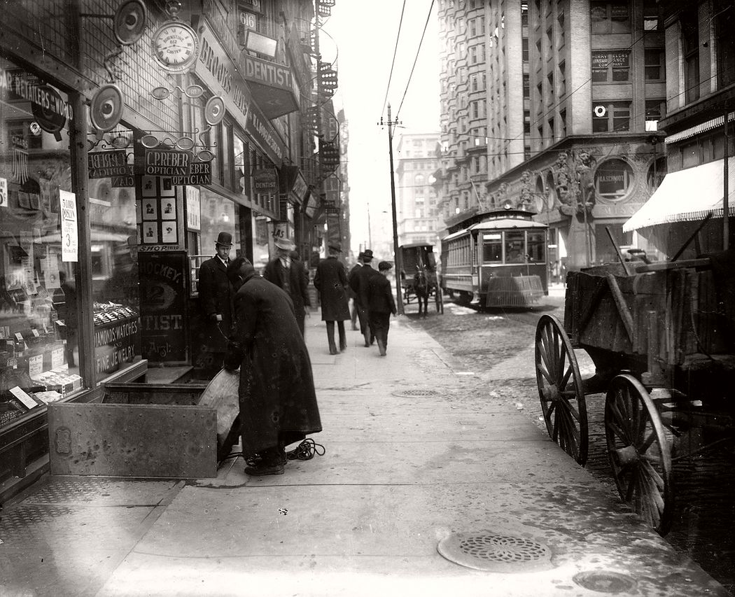 Sidewalk on Olive Street looking west from Seventh Street, ca. 1900s