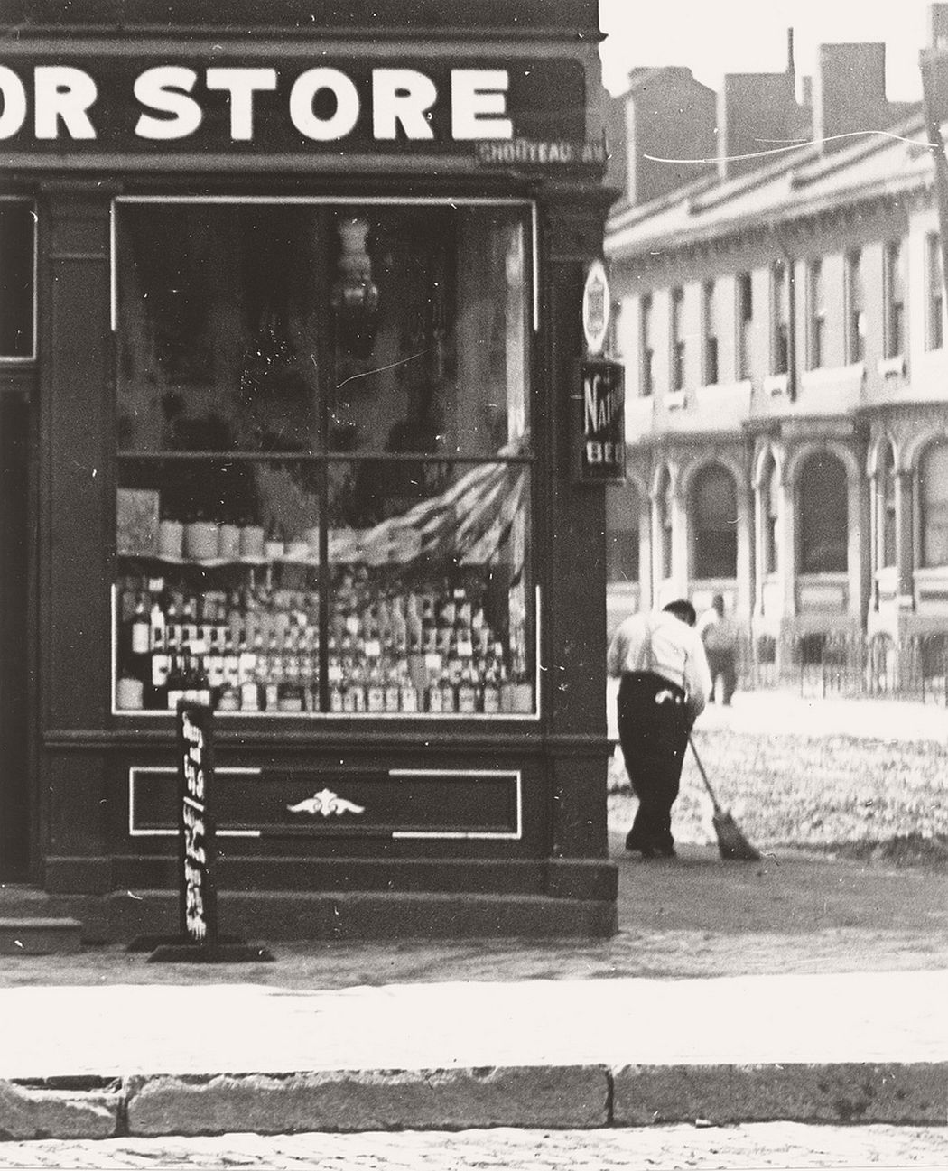 Store front window of a liquor store on Chouteau Avenue, ca. 1900s