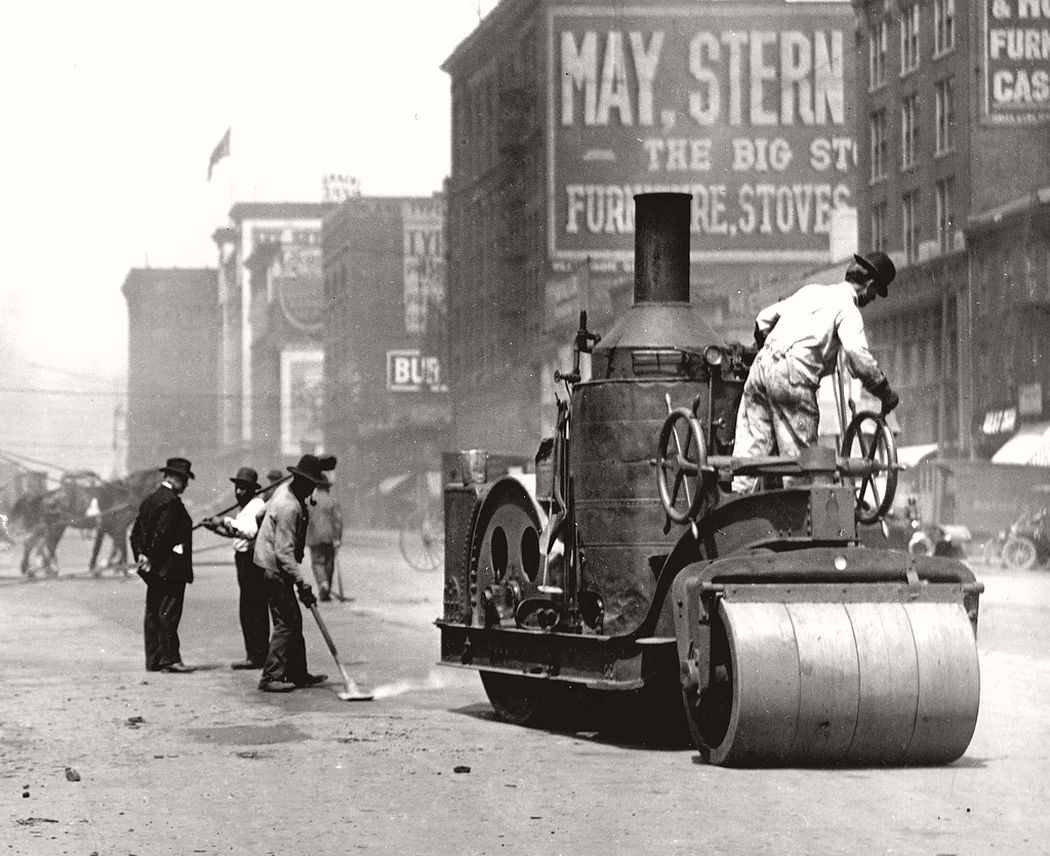 Street workers using a steam roller to repair Twelfth Street between Chestnut and Pine Streets. Photograph, 1910.