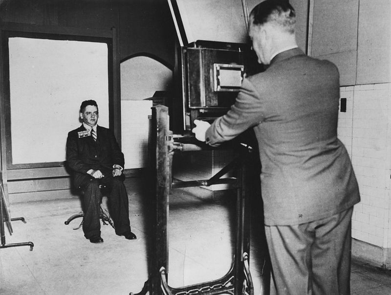 Weegee getting a mug shot at station house, New York, c.1936