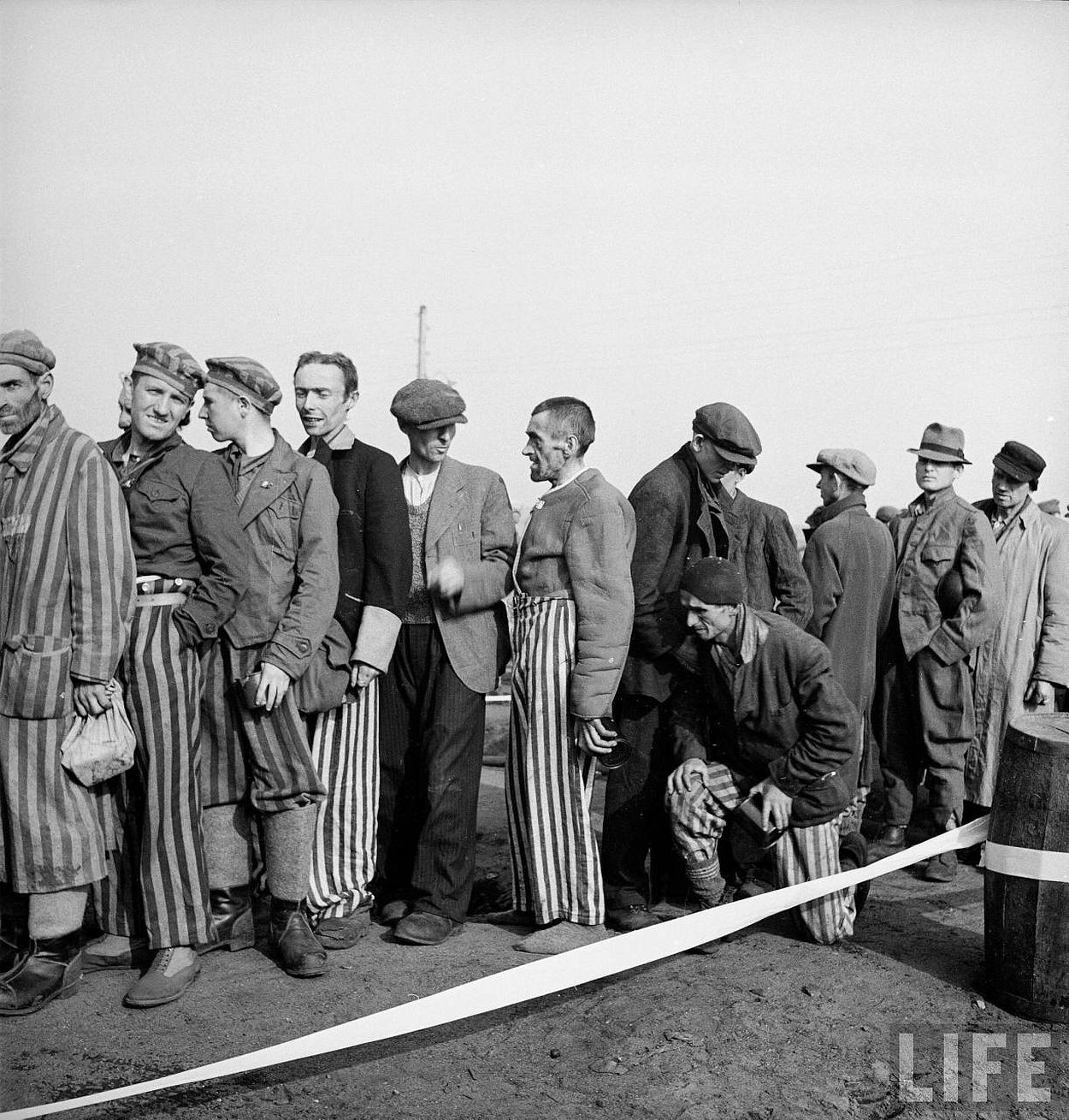 Newly liberated prisoners waiting on line for food at the Bergen Belsen concentration camp.