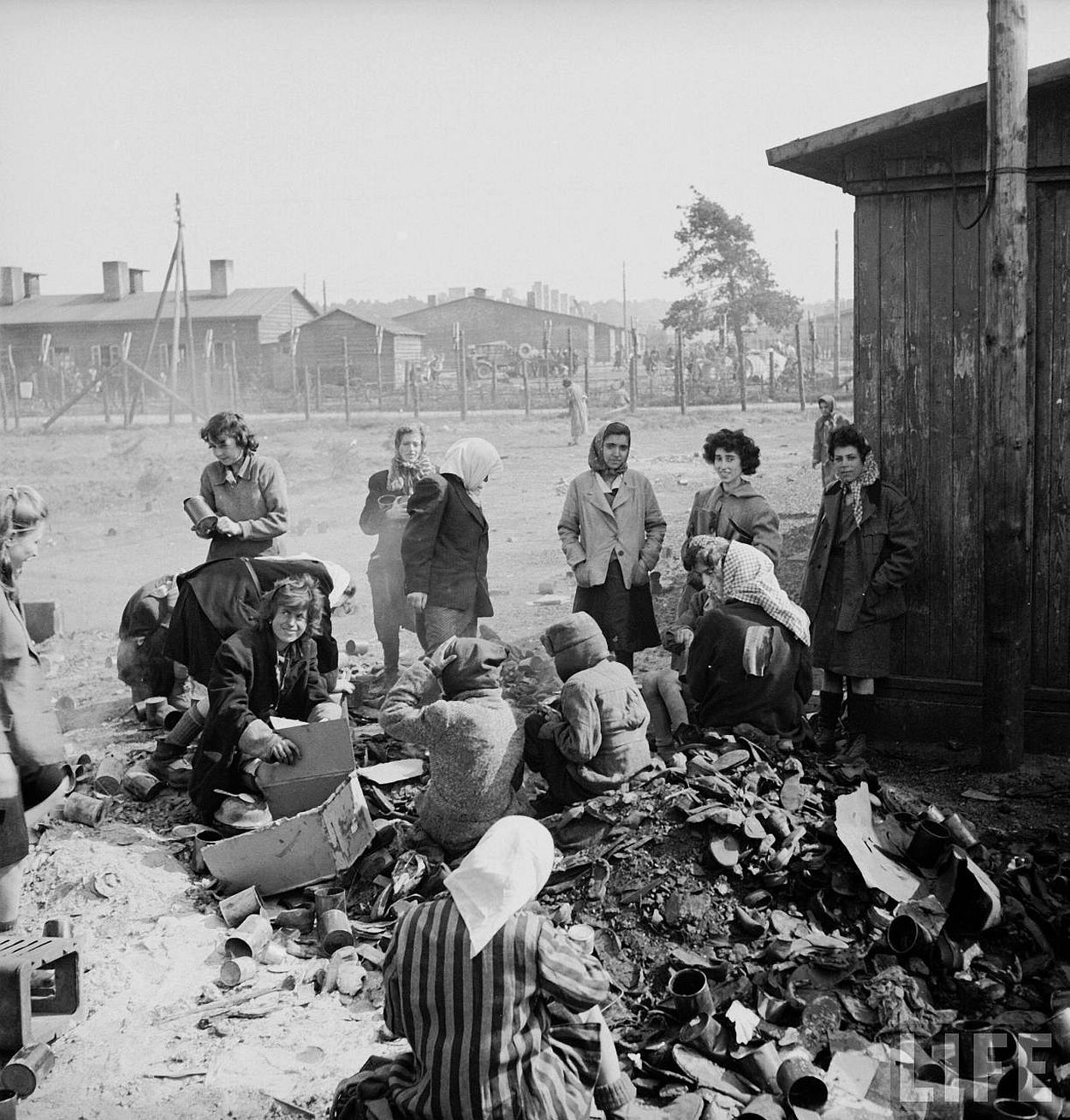 Female prisoners sifiting through garbage for food at the recently liberated Bergen Belsen concentration camp.