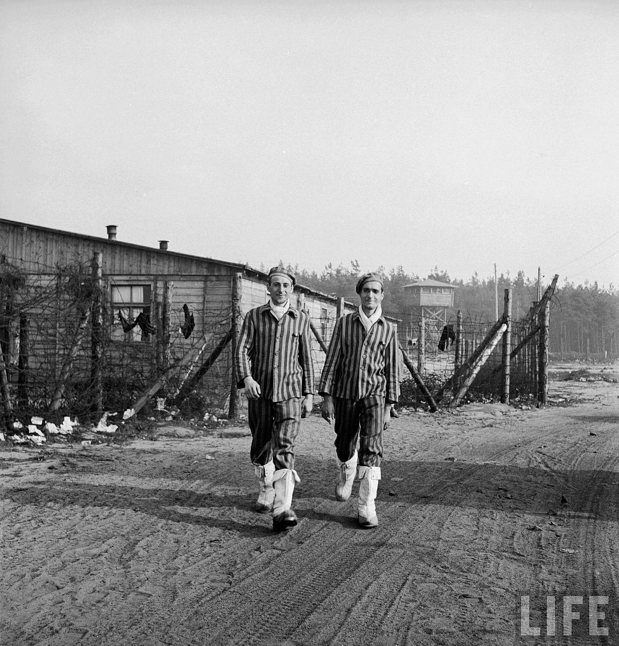 New internees of the freshly liberated Bergen Belsen concentration camp includ this pair of French brothers, Charles and Louis Perret, wearing white boots they took from the Germans.