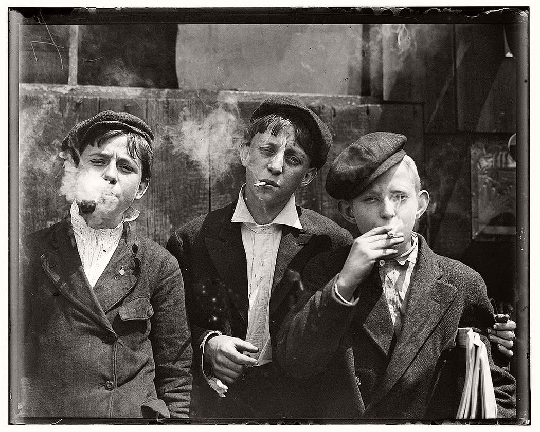 Newsies smoking at Skeeter's Branch, St. Louis, Missouri, May 9, 1910