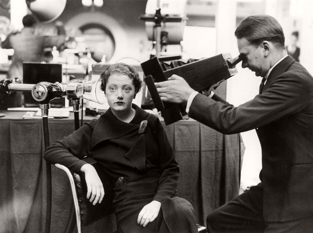 A woman having her head x-rayed with the new shock-proof apparatus at the London Medical Exhibition, Royal Horticultural Hall. The apparatus, which is designed for the consulting room, is simple to use as it can be plugged in to any domestic lighting point'. 1934. (SSPL—Getty Images)