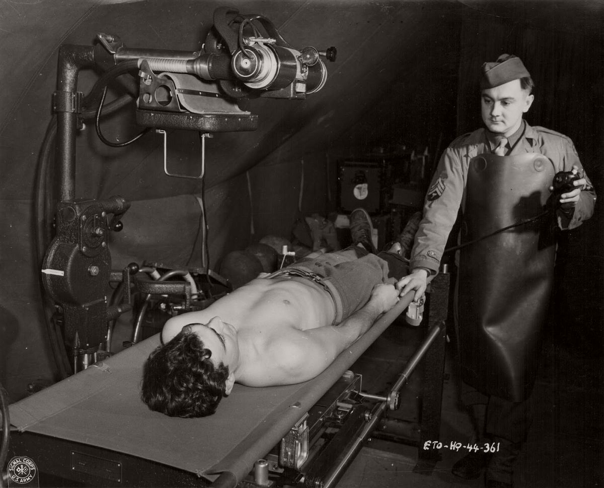 An x-ray technician with the US Medical Corps tending to a wounded soldier during World War Two, circa 1941-1945. (US Army Signal Corps—Getty Images)