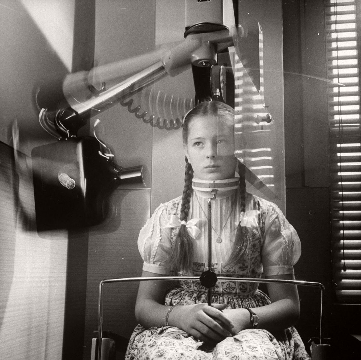 X-ray machine which circles head to take panoramic picture of teeth, eliminating usual mouthful of film, 1960. (John Loengard—The LIFE Picture Collection/Getty Images)