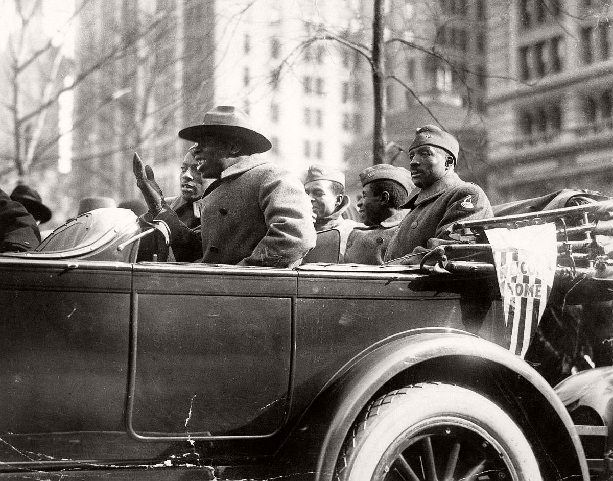 Wounded soldiers of the 369th ride in their victory parade. Feb. 17, 1919. (Bettmann/Corbis)
