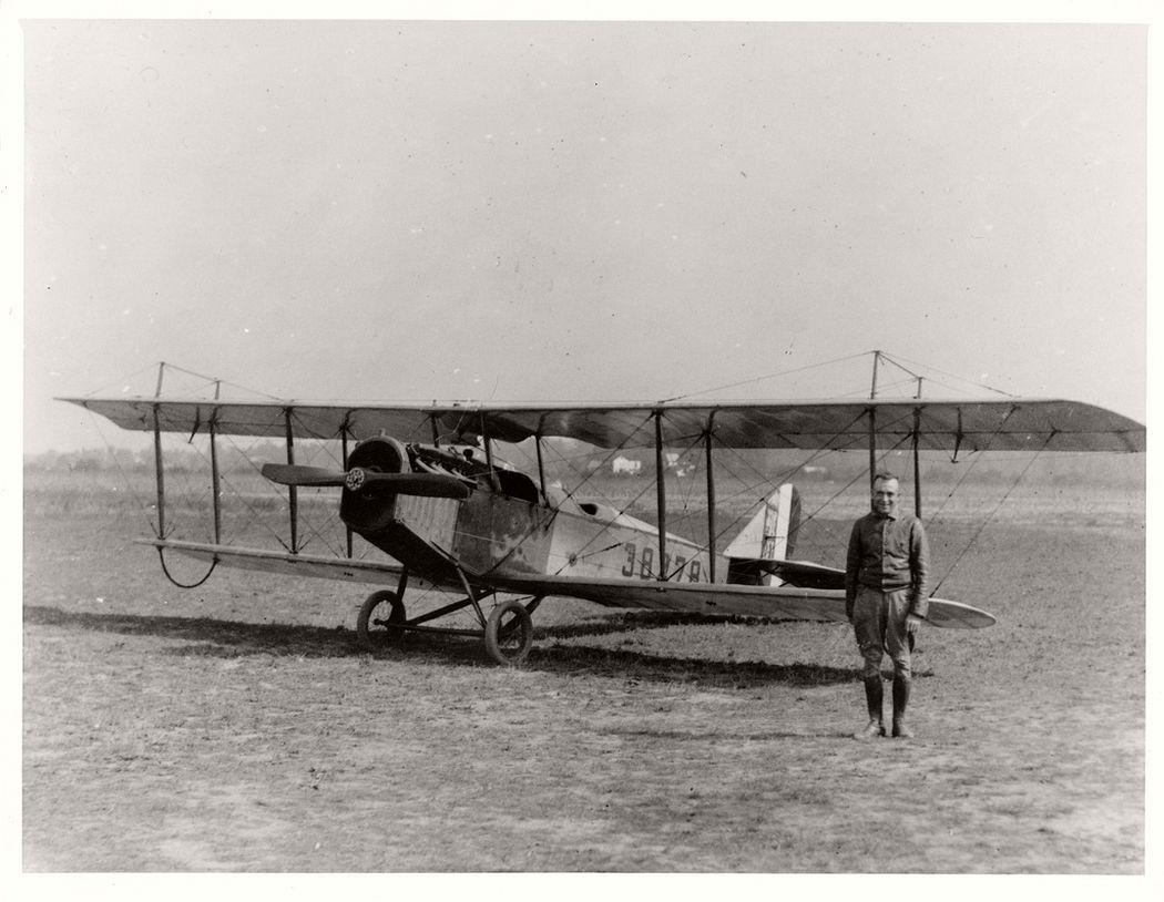 Pilot Eddie Gardner posing in front of an airmail plane, 1918