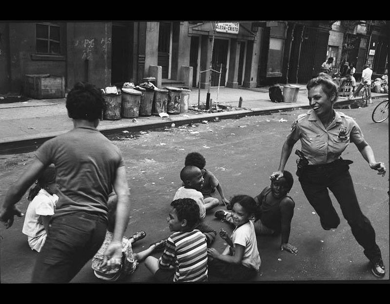 A policewoman plays games with community children. Shortly afterward, the officer became pregnant and was assigned a desk job for the period of her pregnancy, from Police Work, 1978. Leonard Freed (American, 1929–2006). Gelatin silver print; 17.8 x 23.7 cm. The Cleveland Museum of Art, Gift of George Stephanopoulos, 2013.189. Image courtesy of Leonard Freed / Magnum Photos.