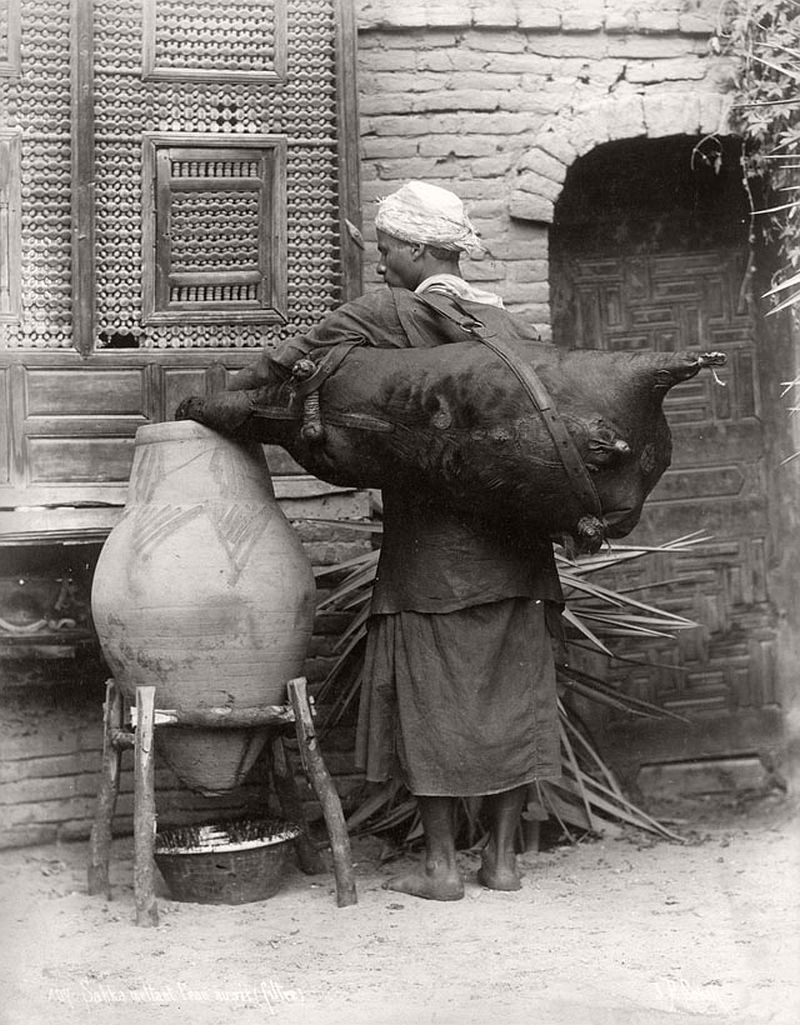 A Cairo man filtering water, 1880