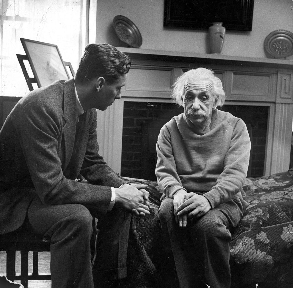 "With Albert Einstein, Cord Meyer Jr. (president of United World Federalists, Inc.) discusses Russia's attitude toward world government. Einstein thinks Russians would first oppose world government then ""once they see they cannot stop it . . . they will collaborate."" (Alfred Eisenstaedt—The LIFE Picture Collection/Getty Images)"