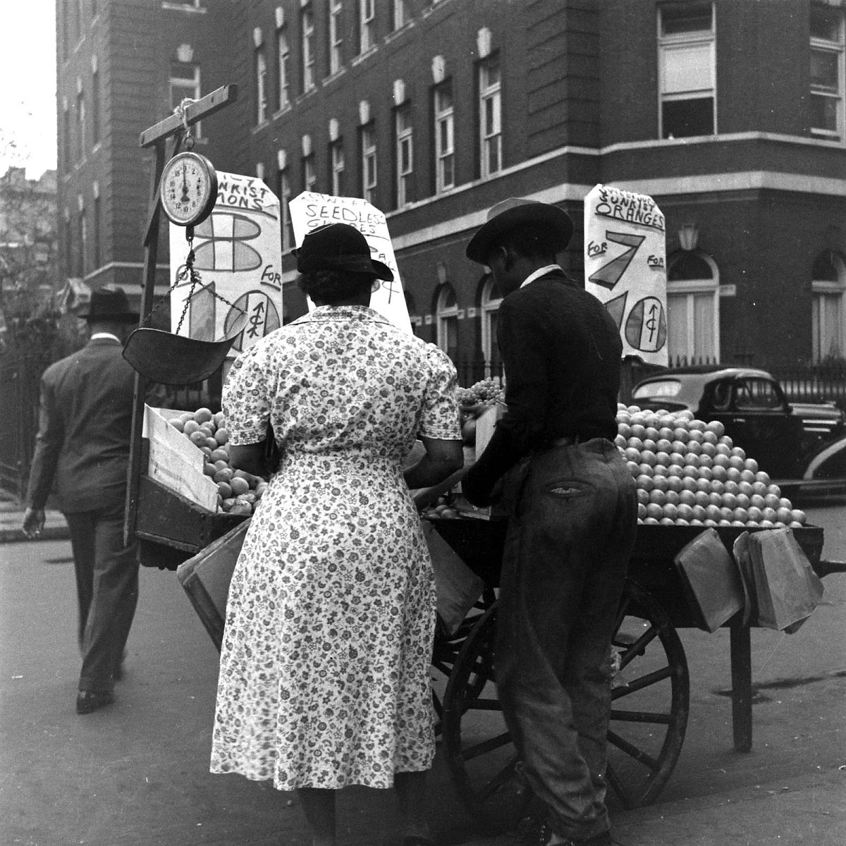 A citrus stand is set up on a Harlem street, 1938.