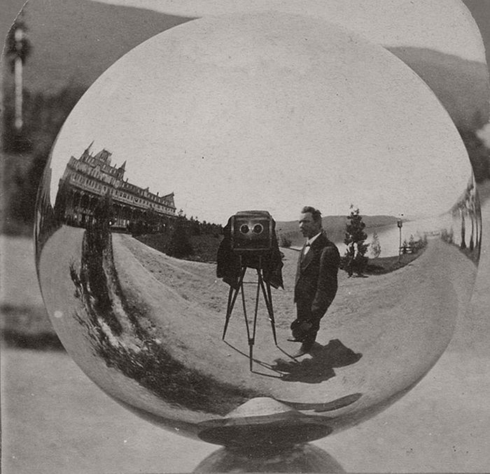 This image is half a stereo card by G.S. Irish of Glen's Falls, N.Y. The Fort William Henry Hotel, Lake George, N.Y.; the photographer; and his stereo camera are reflected in a mirrored gazing ball.