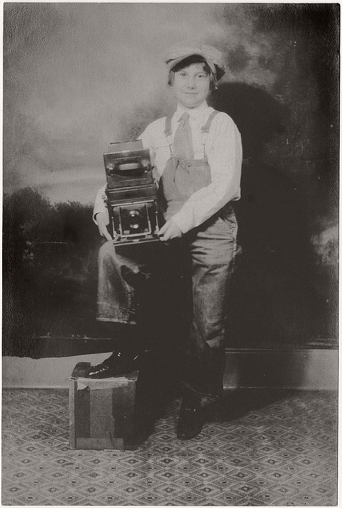 The print shows some free silver in the shadows but the appeal of the young person, a boy we thought, proudly showing off a Graflex type camera was immediate.