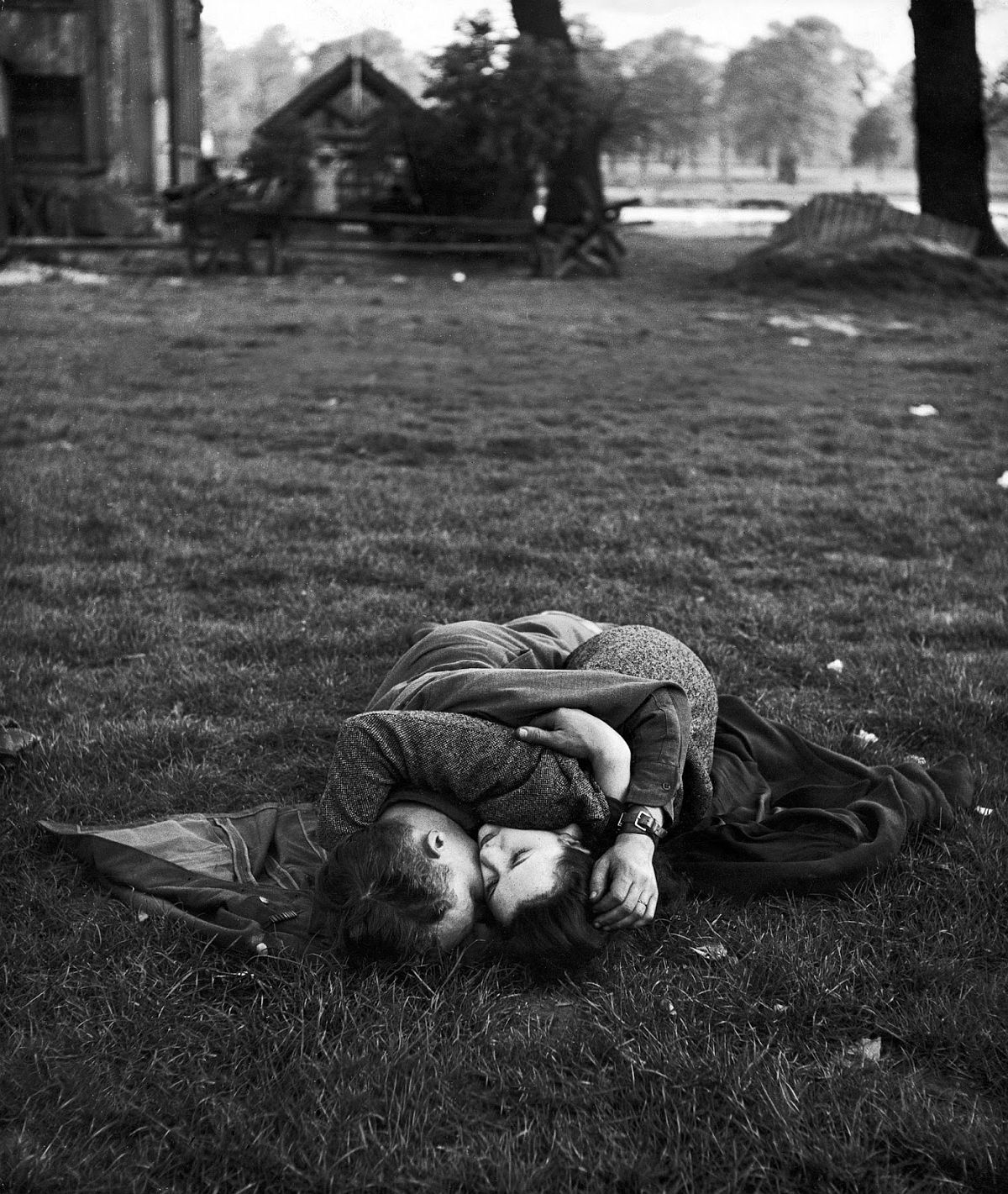 American soldier kissing his English girlfriend on lawn in Hyde Park, one of the favorite haunts of US troops stationed in England.