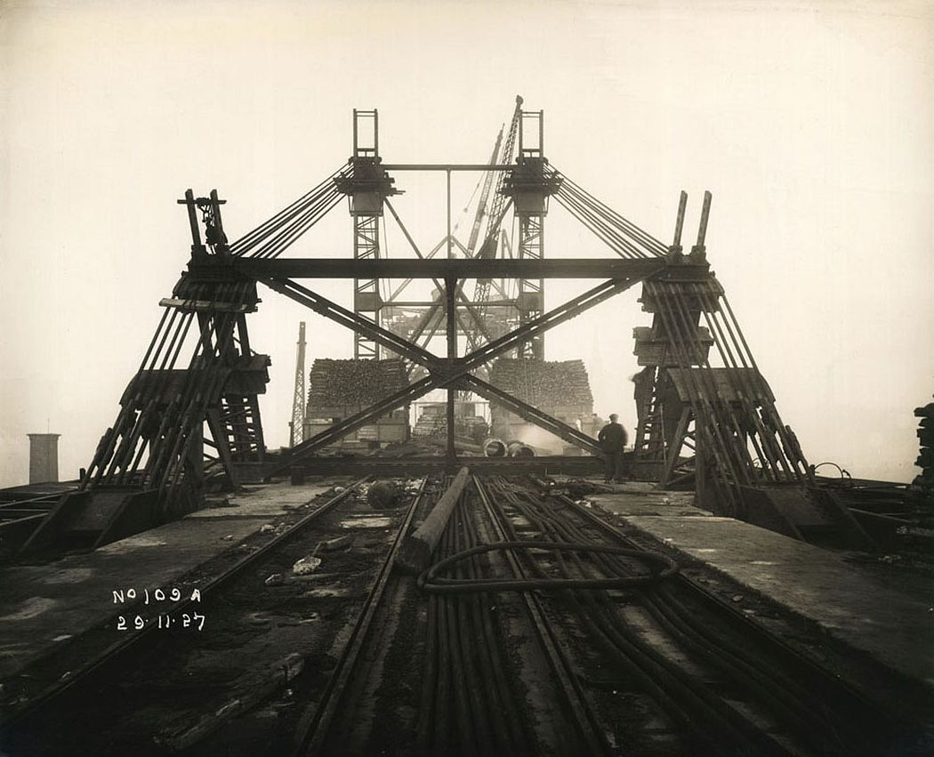 View of support mast and cables holding the Tyne Bridge in place as it is constructed, 29 November 1927