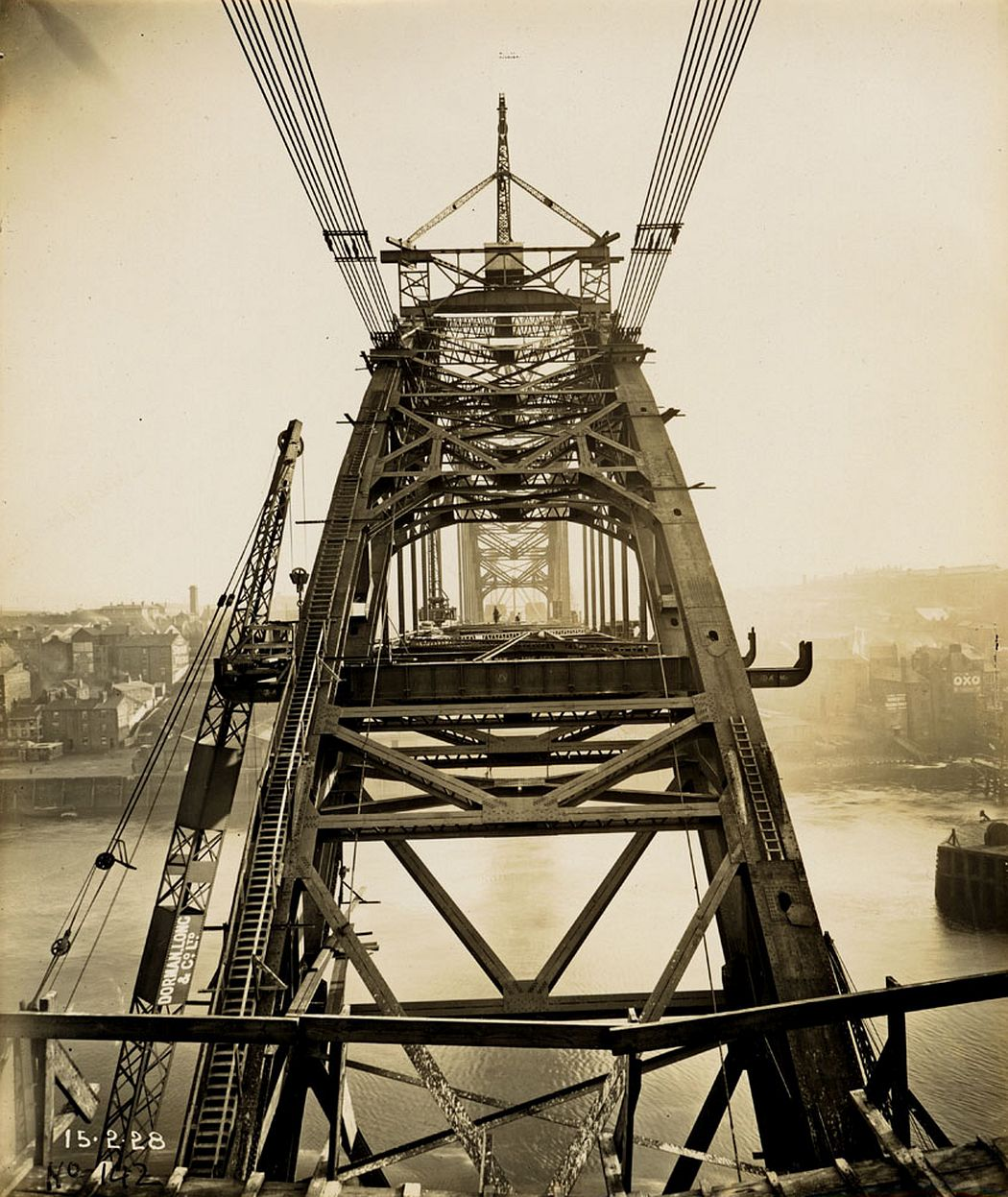 View of the Tyne Bridge captured from the Newcastle side during its construction on 15 February 1928. This shot shows very clearly the cross-bracing on the arch.