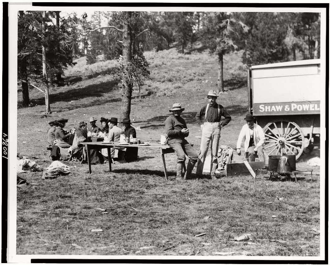 Tourists and guides picnicking in Yellowstone Park, 1903.