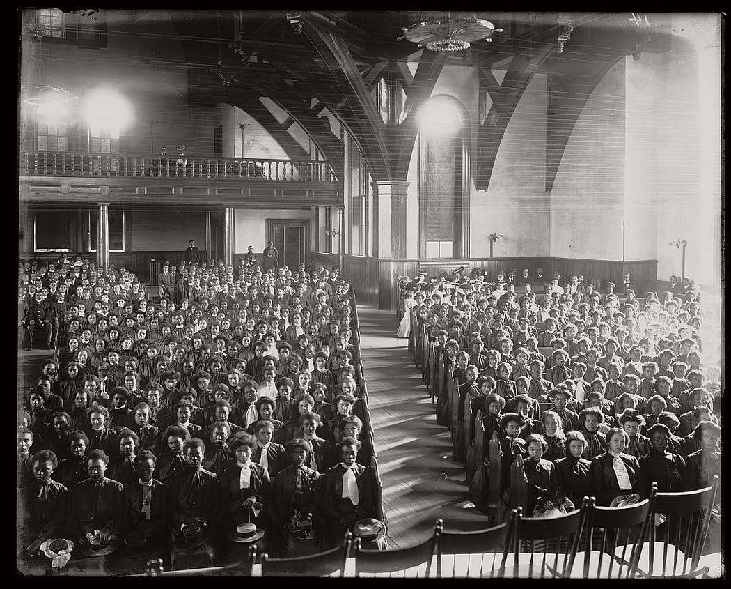 Interior view of chapel filled with female students at the Tuskegee Institute, ca. 1902.