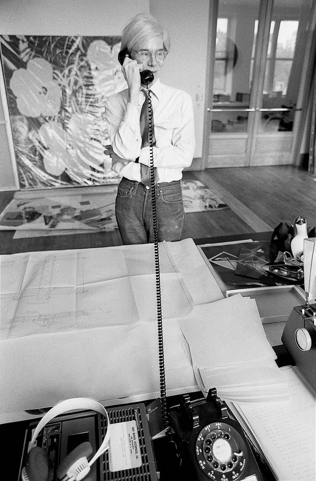 Andy Warhol on the phone at Factory in New York City (1981). Photo: Robert Levin.