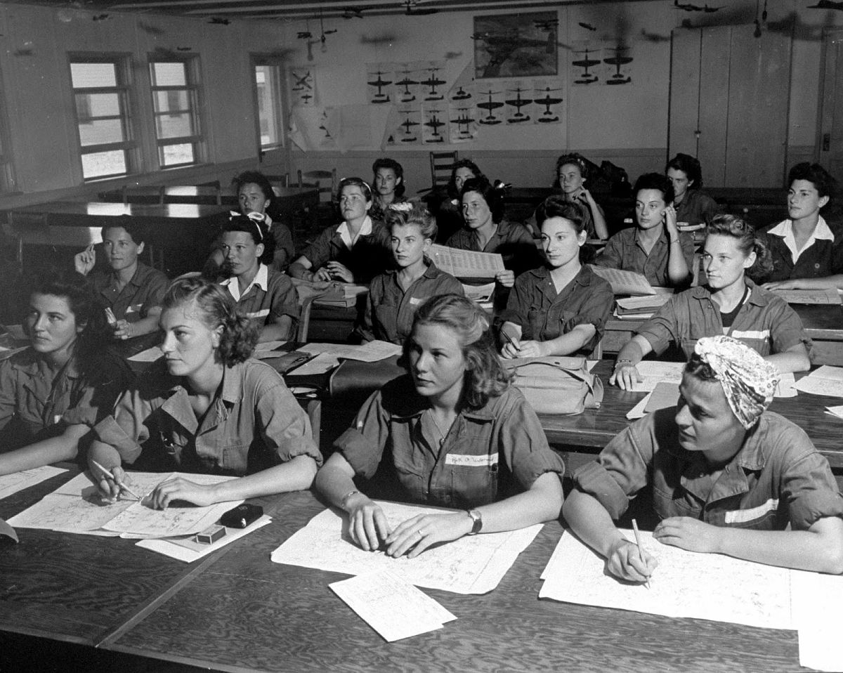In ground school subjects the girls study more diligently than the aviation cadets who preceded them at Avenger Field, according to the instructors. If marks are low students have extra study halls in the evening to catch up. Trainees above are in meteorology class, learning to read symbols and weather maps of the sort that they will use as ferry pilots.