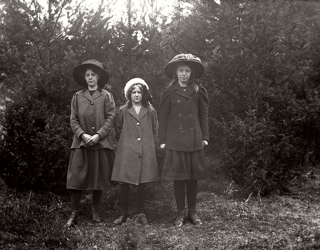 Three girls in the forest.