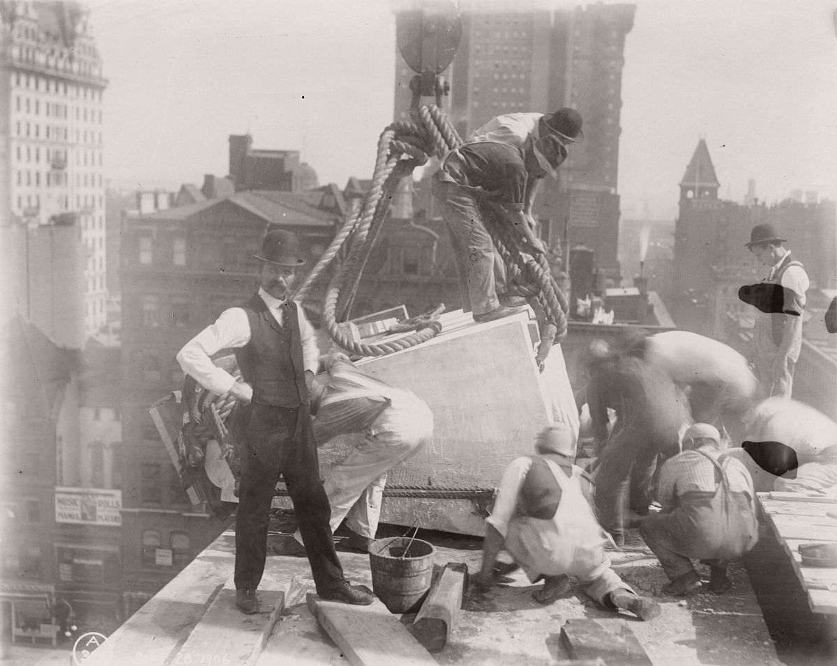 Construction workers position a piece of marble on the roof of the central building of the New York Public Library, 1906. Photograph: New York Public Library