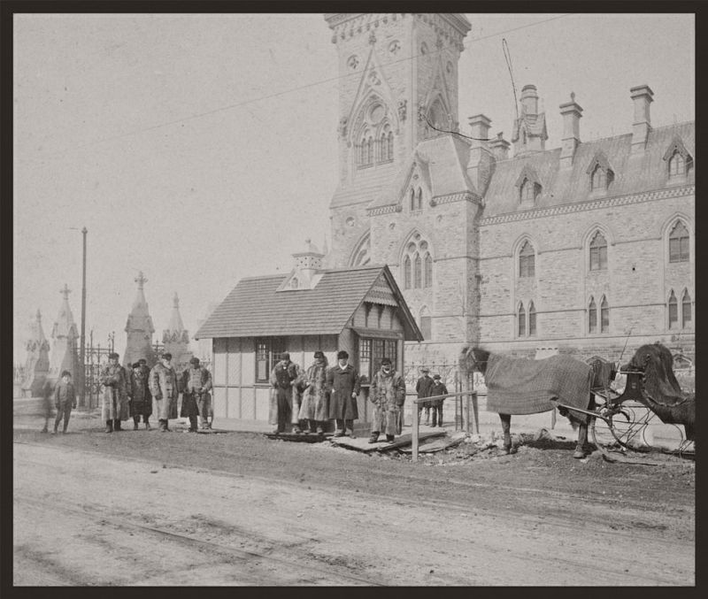Horse drawn cab stand in front of the East Block, 1897