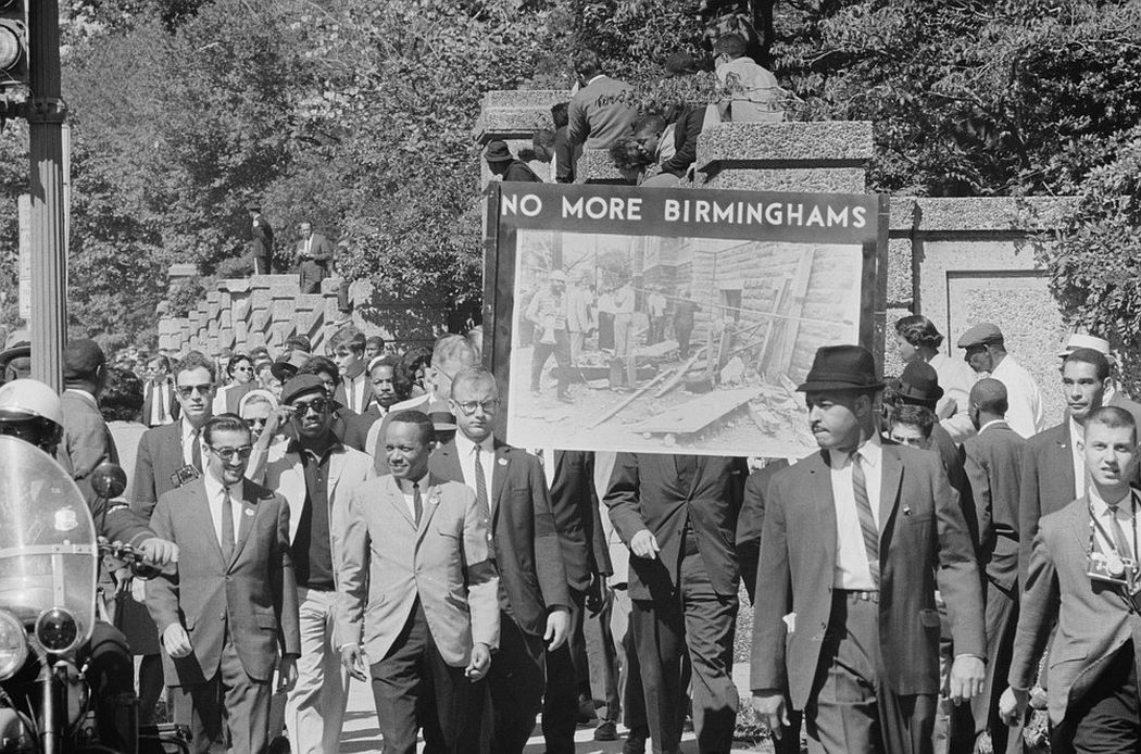 """Congress of Racial Equality members conduct a march in memory of those killed in the Birmingham bombings, carrying a sign that says """"No More Birminghams"""" in Washington D.C., September 22, 1963. (Photo by Reuters/Library of Congress)"""