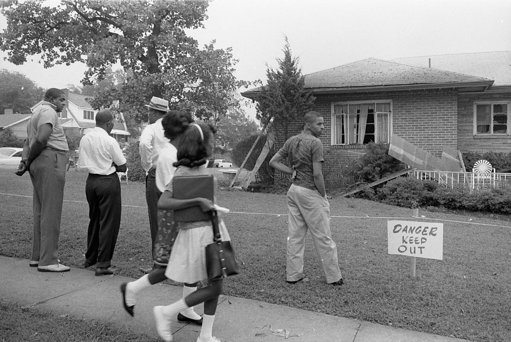 A group viewing the bomb-damaged home of Arthur Shores, NAACP attorney, in Birmingham, Alabama, September 5, 1963. (Photo by Reuters/Library of Congress)
