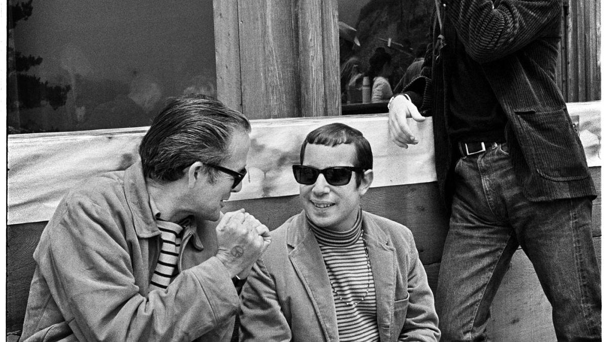 Ralph Gleason with Simon and Garfunkel.