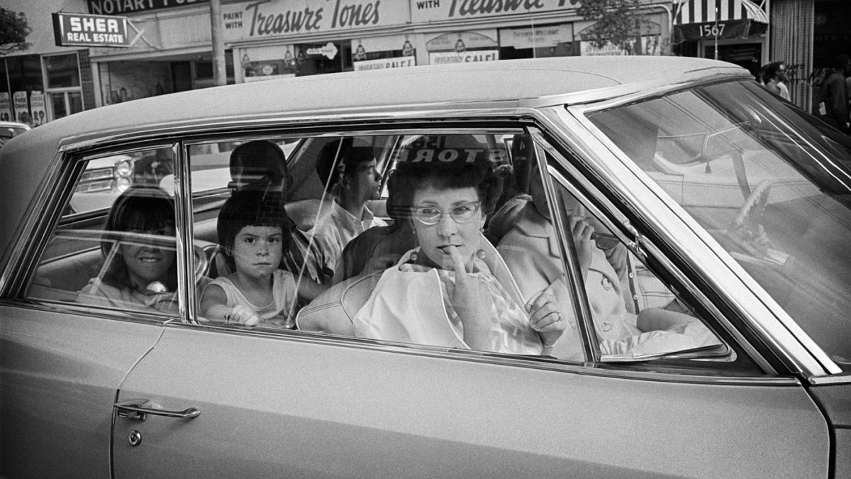 Tourists observe the Haight from their cars in 1967.