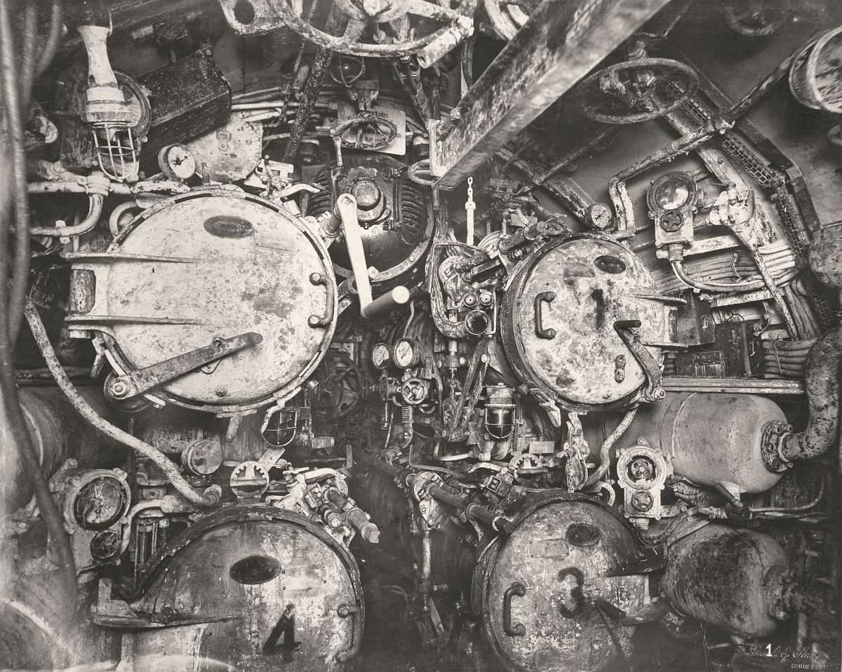 This photographs shows the U-Boat 110, a German Submarine that was sunk and risen in 1918. This photographs shows a forward view of its four Torpedo Tubes.