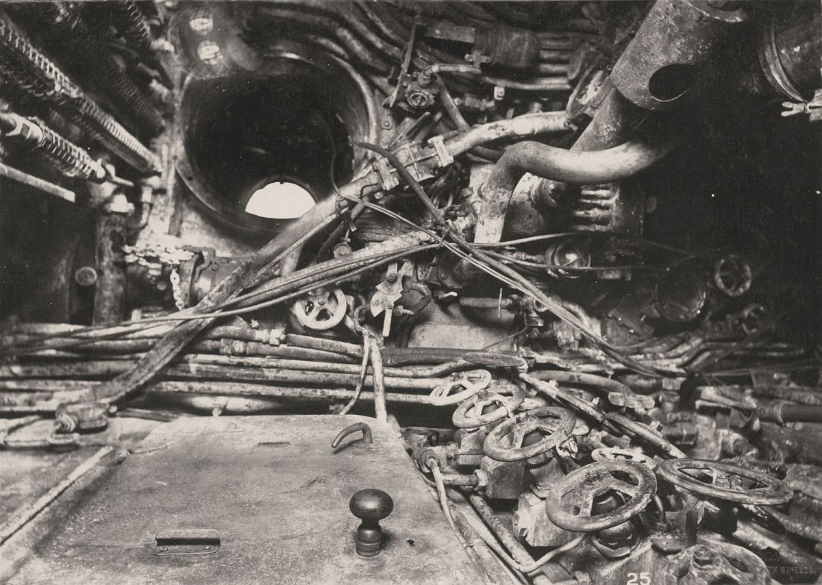 This photograph shows the U-Boat 110, a German Submarine that was sunk and risen in 1918. This photograph shows the Control Room and access scuttle to the conning tower.