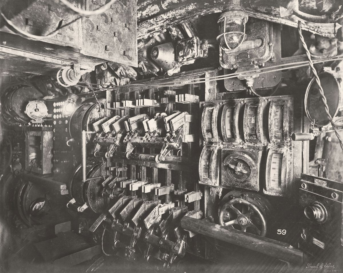 This photograph shows the U-Boat 110, a German Submarine that was sunk and risen in 1918. This photograph shows the Submarine's Electric Control Room and switch gear.