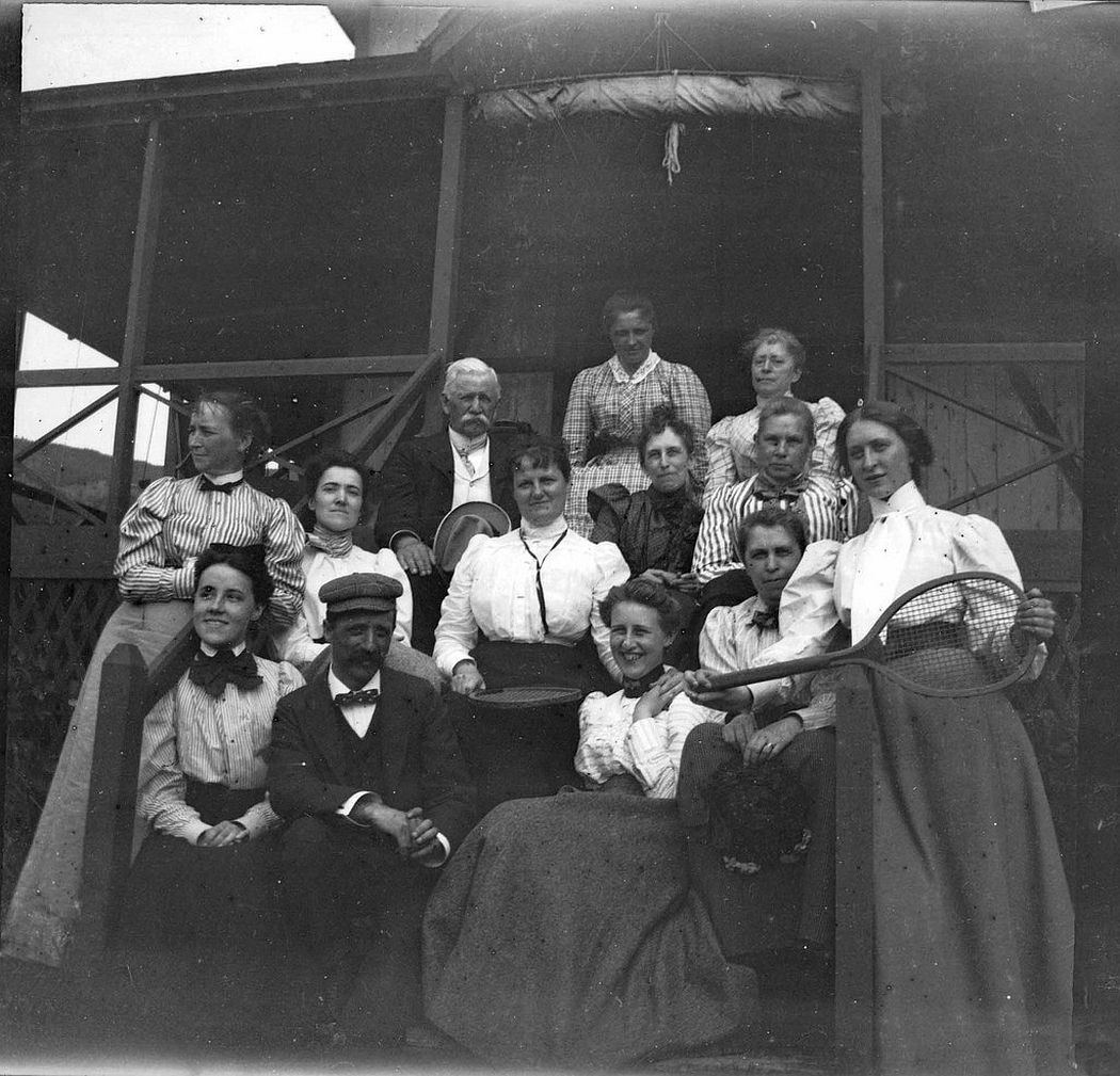 Camping crowd at Ogier Point, August 1900. Theresa's sister Grace Parker is on the right with the tennis racket, and Father Brown is seated in back with white hair.