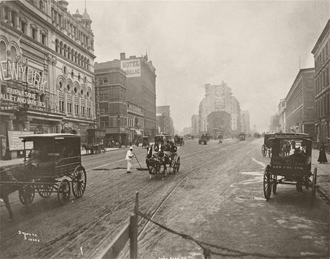 On the left, the former Hammerstein's Olympia entertainment complex, part of which became the New York Theatre (name visible). In the distance is the back of the Pabst Hotel, partly blocked by four-story buildings which share its block. The Hotel Cadillac on the northeast corner of 43rd Street is in the middle distance. circa 1900.