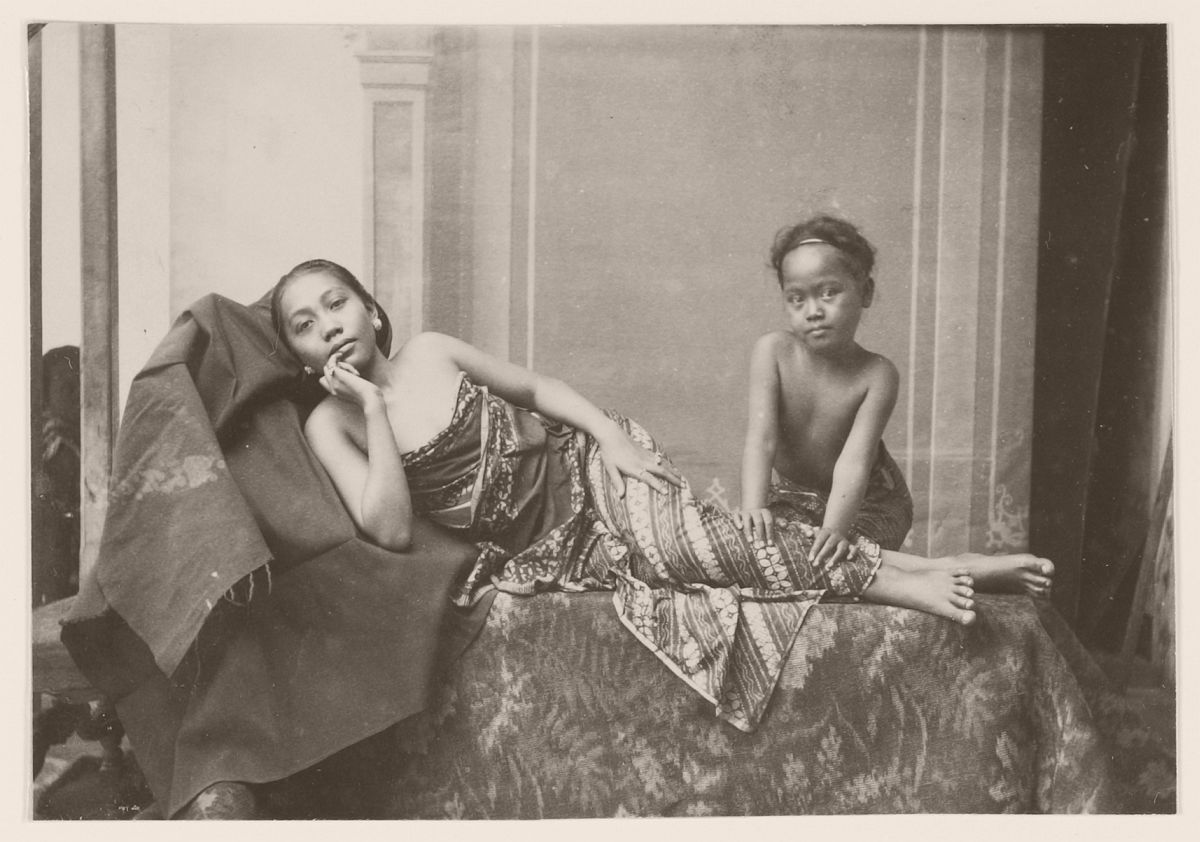 Young woman massaged by a child in Java, 1901