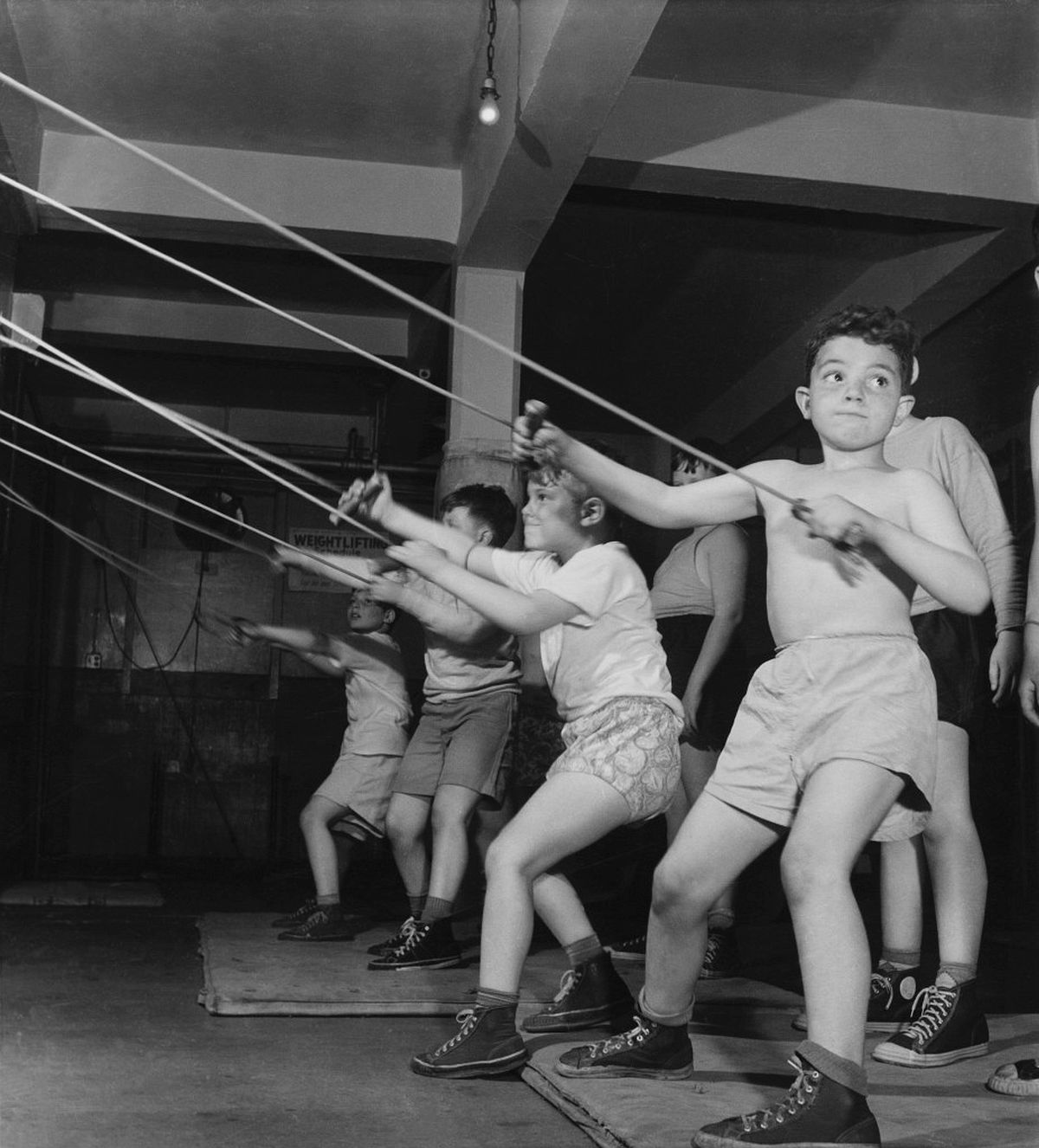 Roman Vishniac, [Boys exercising in the gymnasium of the Jewish Community House of Bensonhurst, Brooklyn], 1949. Gelatin silver print. © Mara Vishniac Kohn, courtesy International Center of Photography.