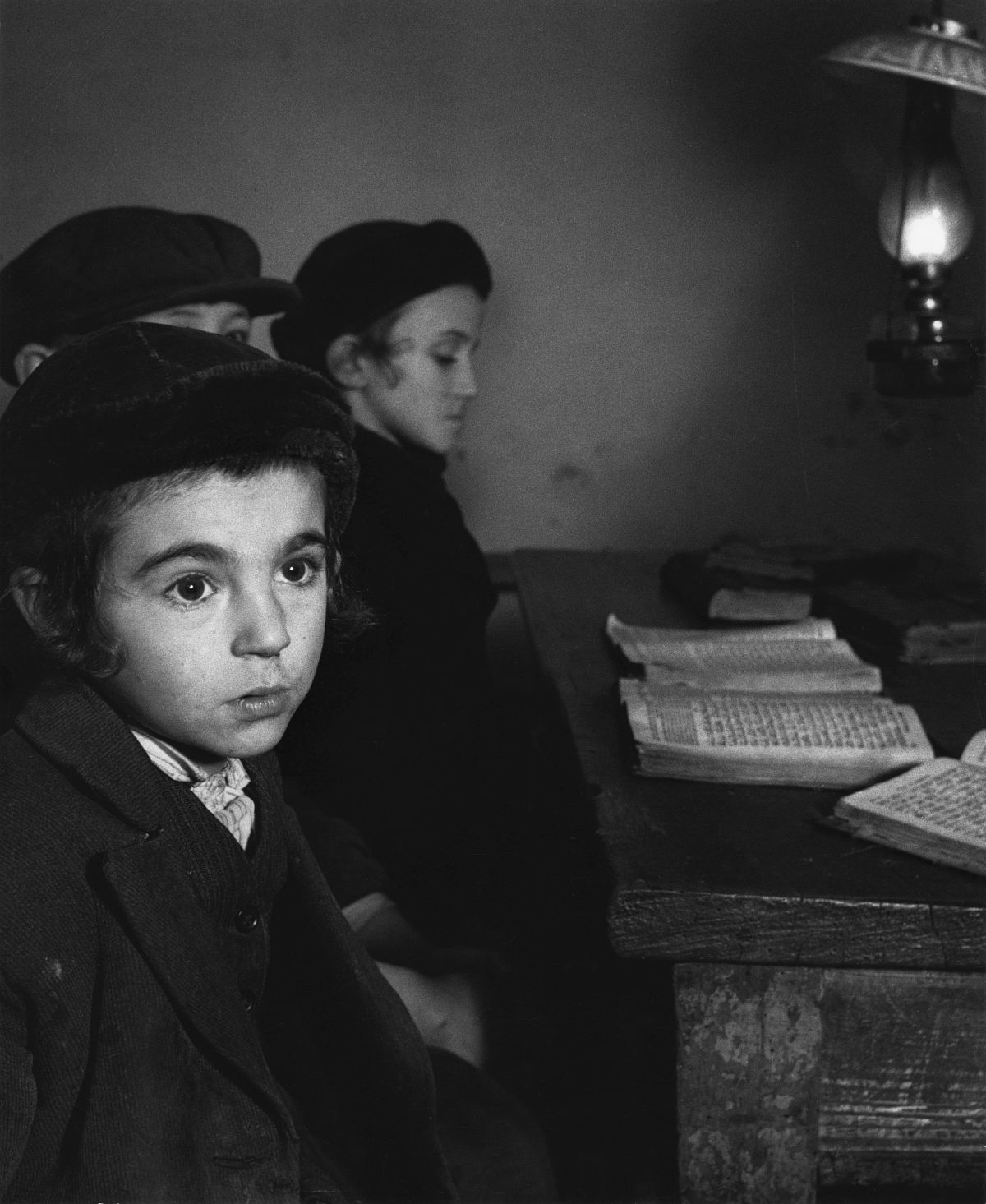 Roman Vishniac, [David Eckstein, seven years old, and classmates in cheder (Jewish elementary school), Brod], ca. 1938. Gelatin silver print. © Mara Vishniac Kohn, courtesy International Center of Photography.