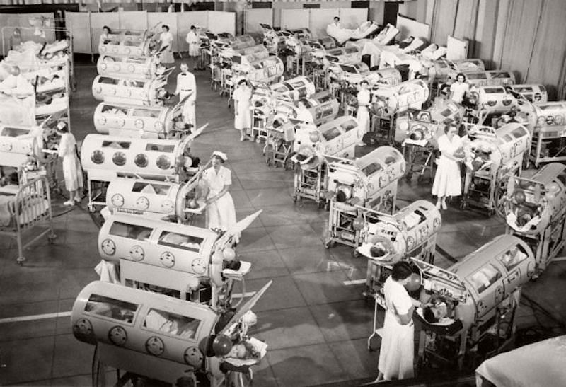 Because iron lungs were mostly available in large cities, family from small cities or rural areas often had to travel long distances to visit their family member in a hospital that had iron lungs available. The polio epidemic had just peaked when this photo was taken at Rancho Los Amigos Hospital in Downey, California.