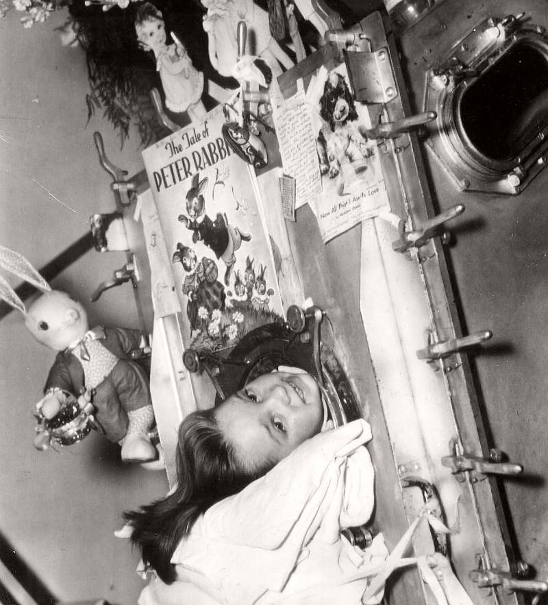 Betty Sue Martin, 5, can still smile after 35 days in an Iron Lung at Johns Hopkins Hospital, ca. 1937.