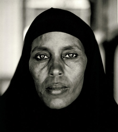 Fazal Sheikh, Abshiro Aden Mohammed, Women's Leader, Somali Refugee Camp, Dagahaley, Kenya, 2000, from the series A Camel for the Son. © Fazal Sheikh