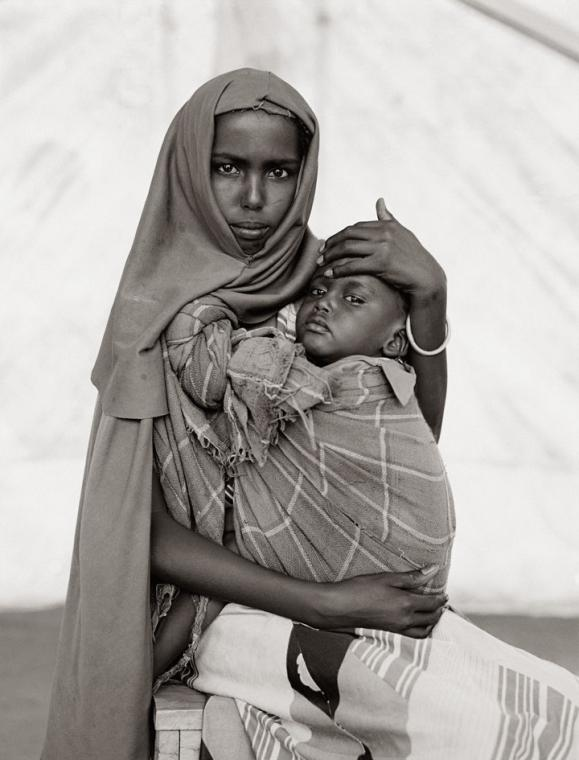 Fazal Sheikh, Alima Hassan Abdullai and her brother Mahmoud, Somali refugee camp, Mandera, Kenya, 1993, from the series A Camel for the Son. © Fazal Sheikh