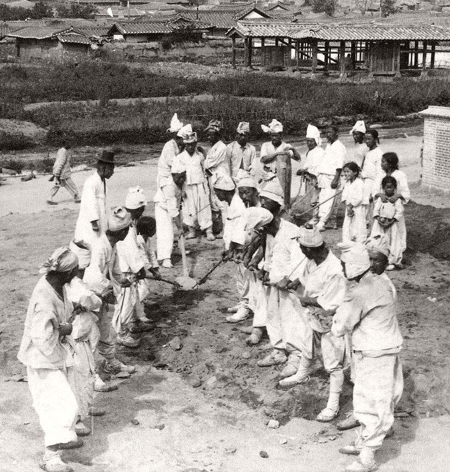 The human back-hoe laying the foundation for a new post office in Seoul, 1903