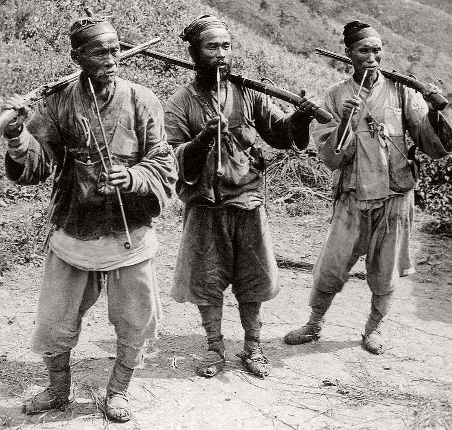Tiger hunters in the hills outside of Seoul, ca. 1900