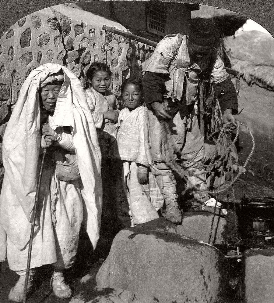 Happy kids with grandma and the water boy, Seoul, ca. 1900
